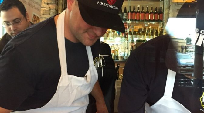 Lake Oswego Firefighters help raise money by cooking pizza