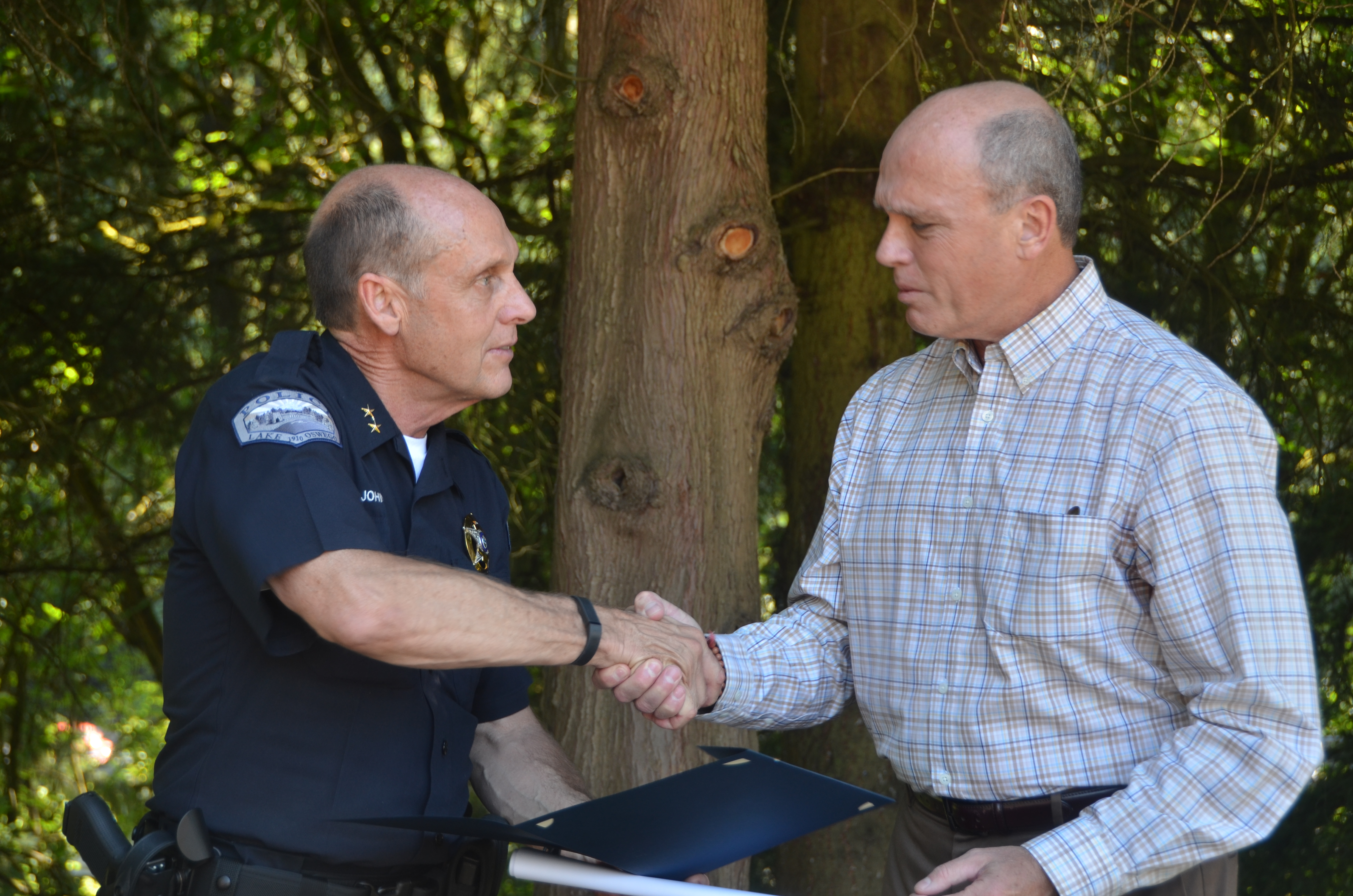 Chief shakes Leonard's hand