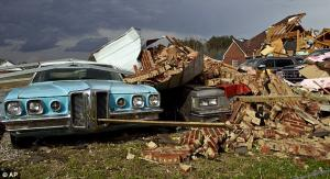 A Cadillac is crushed by fallen bricks in Athens Alabama 012312 Photo AP