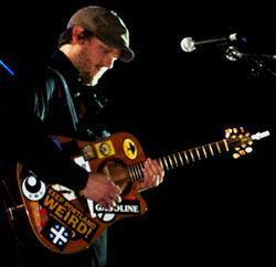Eric John Kaiser with guitar
