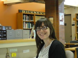 woman librarian at a reference desk