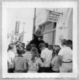 old photo of smokey the bear with kids outside of first lake oswego library