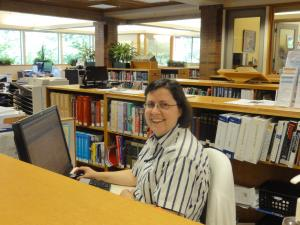 woman at a library reference desk