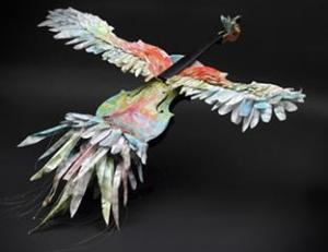 voilin fashioned into a bird