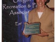 Kim Gilner accepting ORPA Award