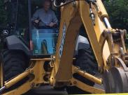 Mayor Studebaker operating the backhoe to break ground!