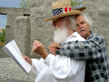 David Hedges and Walt Curtis at the annual Stonehenge War Memorial Poetry Reading, an event they co-founded in 1999. Curtis produced the painting on the front cover of The Changer.