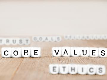 Individual white cube blocks with letters that spell Core Values, Ethics, Trust and Goals