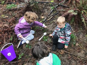 preschooler digging at nature walk